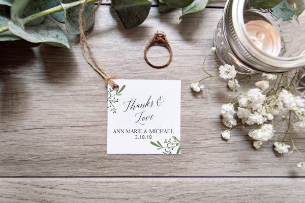 trendy script favor tag with green foliage
