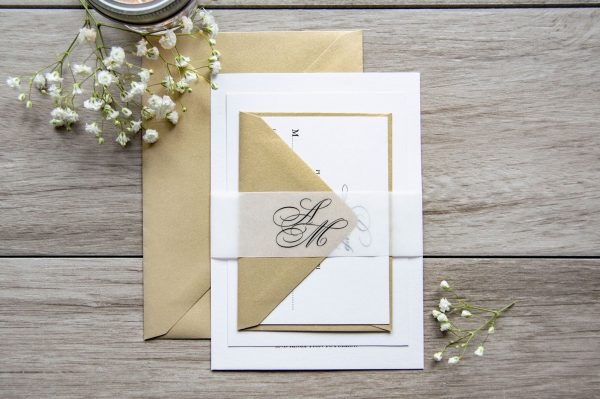 Classic gold wedding invitation with vellum initials belly band