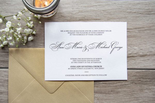 Classic gold wedding invitation with black ribbon