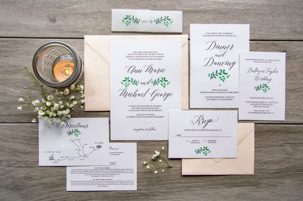 Trendy wedding invitation with eucalyptus watercolor, blush envelope, and vellum belly band