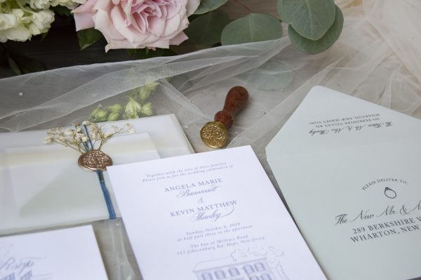 Story book wedding illustrated invitation with wax seal and pressed flowers. The Inn at Millrace Pond, NJ