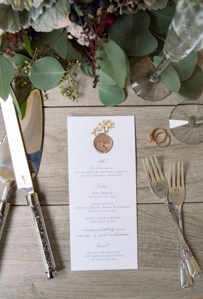 Story book wedding menu with wax seal and pressed flowers. The Inn at Millrace Pond, NJ