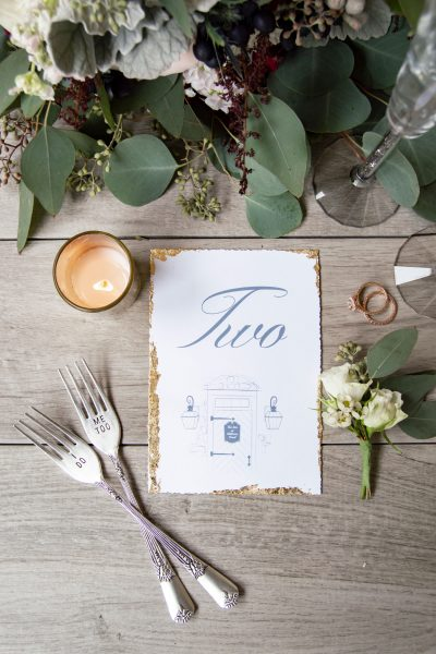 Story book wedding illustrated table number with gold leaf edge. The Inn at Millrace Pond, NJ